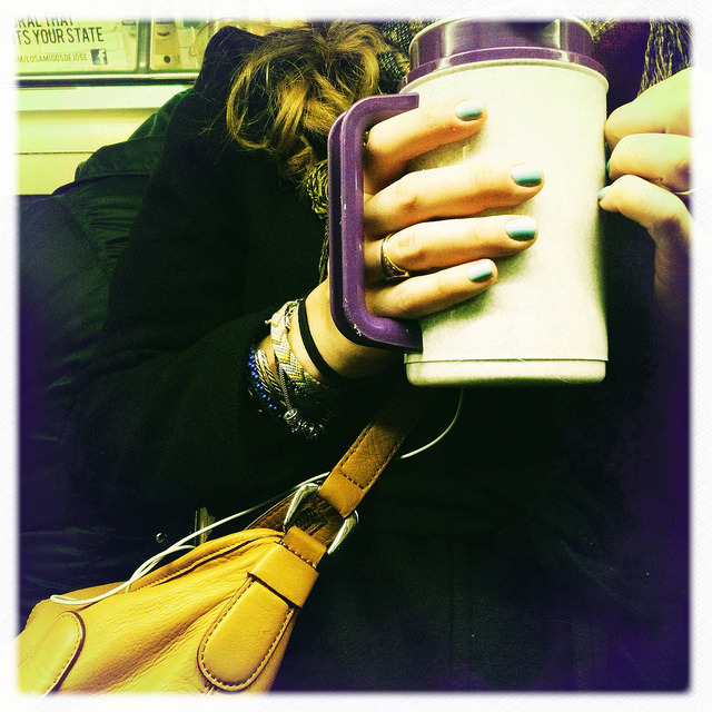 clutching coffee. on Flickr.For many, coffee in the morning is essential.
