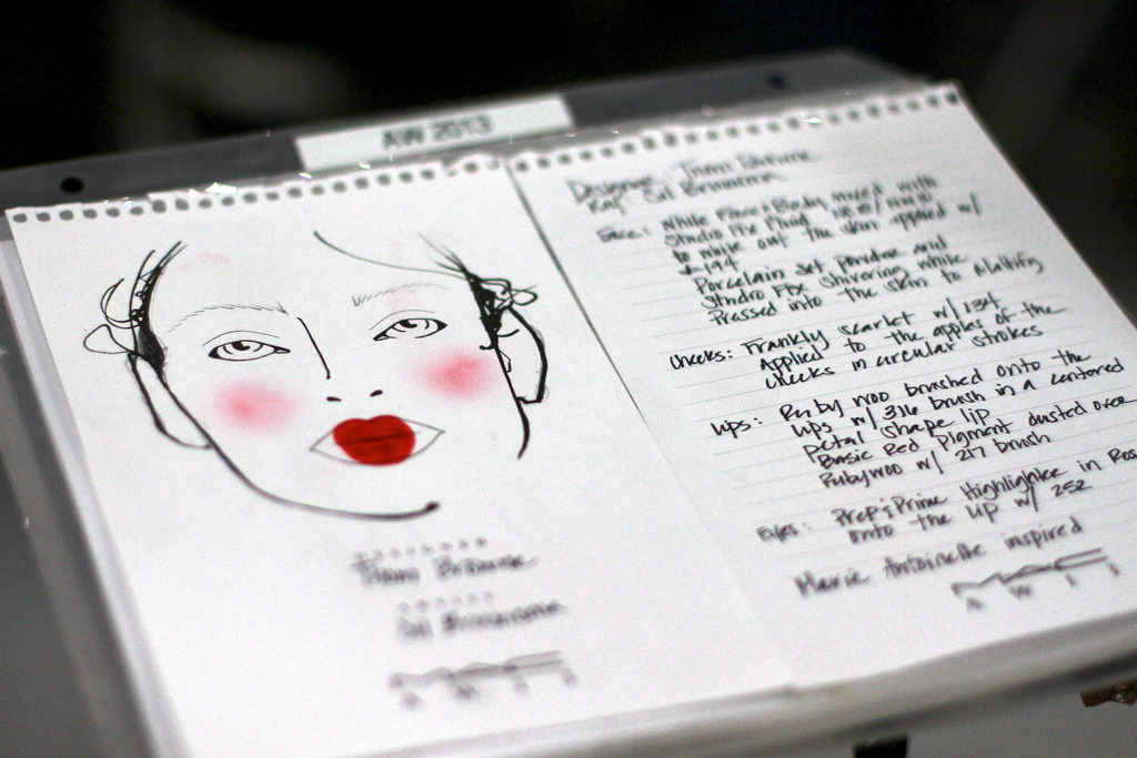 MAC for Thom Browne Okay, so you might not go for the shape of the lips Thom Browne chose for his models this season, but you should certainly go for the color. MAC went with Ruby Woo lipstick, dusted over with Red Pigment to create a hyper-saturated finish. Click through the above links to see what you can score on eBay. (Photo courtesy of thegreyestghost. Text by Jenny Bahn)
