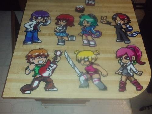 somewhatexquisite:  randm1:  My Perler bead collection #3. Scott Pilgrim characters (so far…. more to come). Top left to bottom right. Gideon, Kim, Ramona, and Knives. Scott w.his bass, Roxie, and Envy. What do you guys think? Any suggestions? Anything that anymore would life made for them? Lemme know!! Requests can made right here or emailed to Lynchfan325@yahoo.com  These are amazing