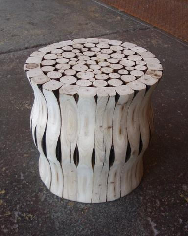 Such a cutie! The Groove Stool from Area 51 Antiques.