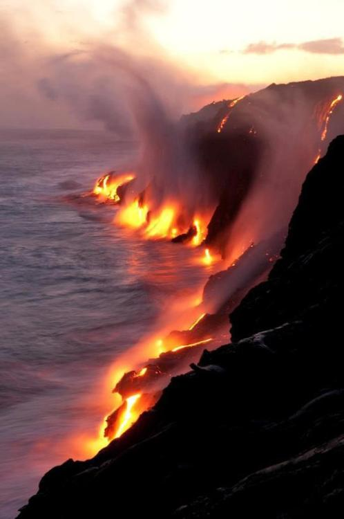 lava flowing towards the ocean in Hawaii