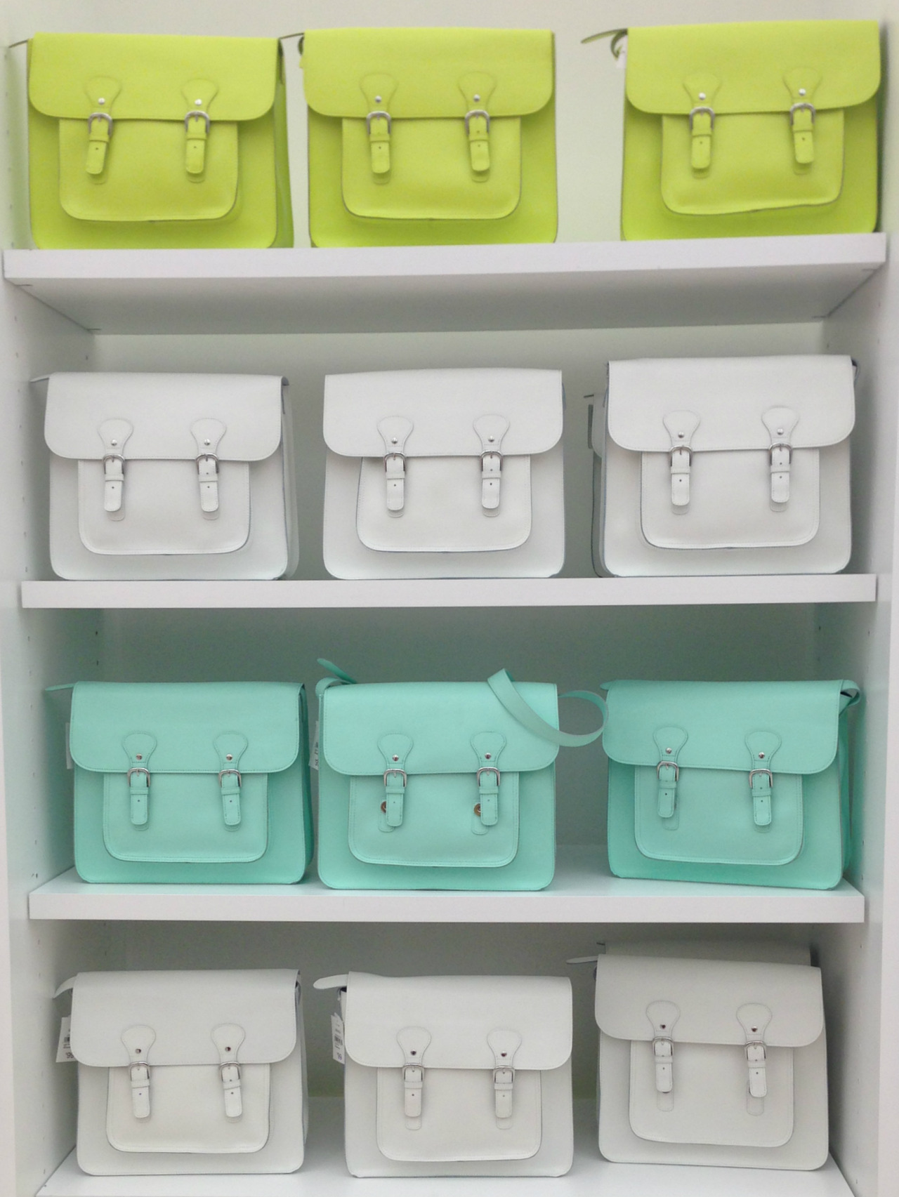 wgsn:  Chalky pastel satchel display in store at Joe Fresh… We want!! WGSN store shot, New York