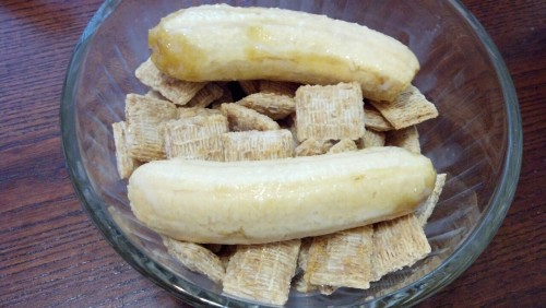 Shredded wheat and mini bananas in almond milk