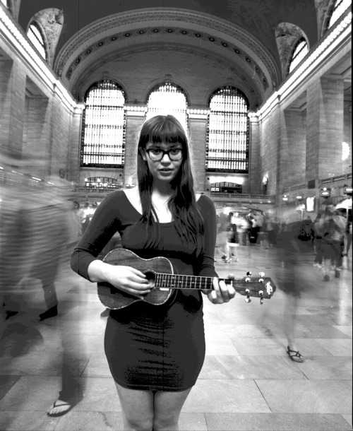 filmphotos:  Sierra McKenzie in Grand Central Station, NYC.  Holding still.  Holding very, very still. I tried getting Sierra to jam out on the Eukelele.  She rocks it btw. Just noticed, people go to GCC in flip flops, apparently.  Ew.  Dumb ass tourists. Ha! Mamiya RZ67 ProII w/ 110mmTri-X 400 (c) Dan Tsui (filmphotos.tumblr.com)