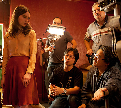fuckyeahdirectors:  Mia Wasikowska and Chan-wook Park on the set of Stoker (2013)