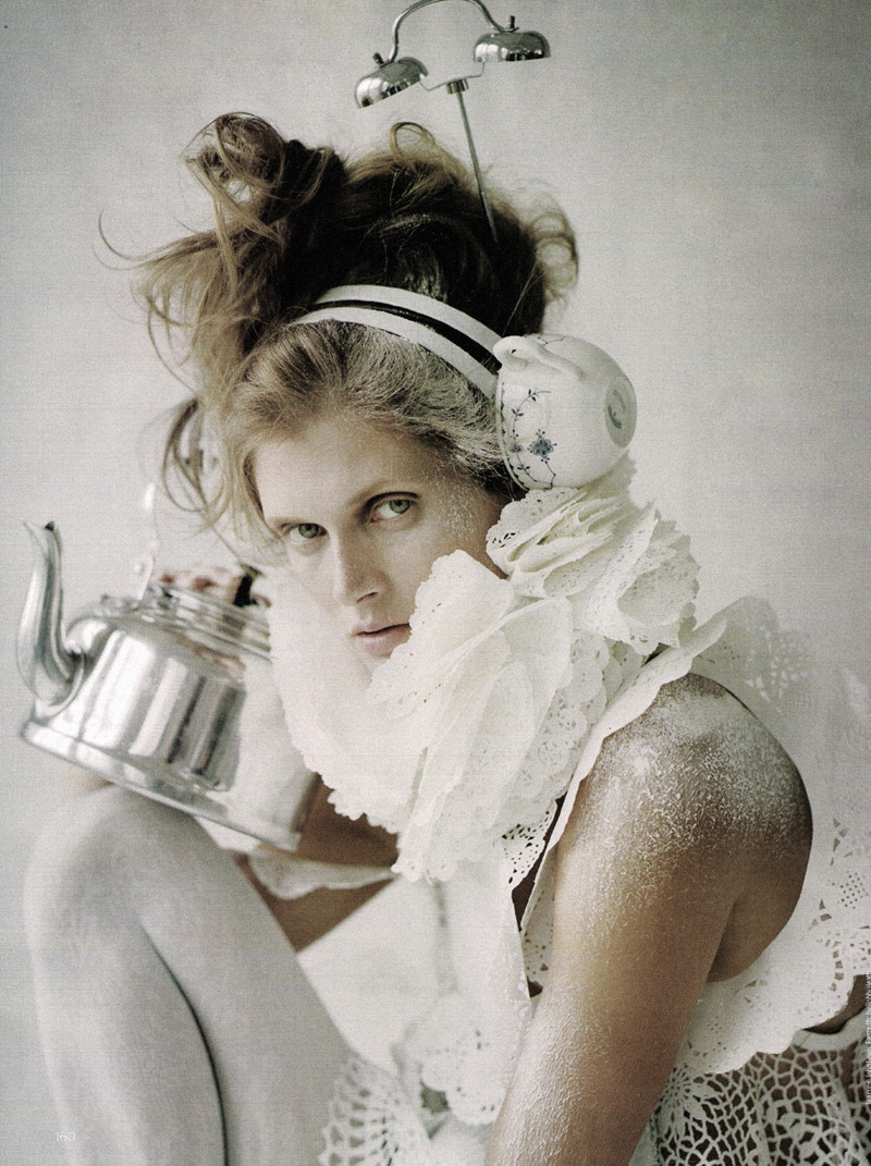 "romanticnaturalism:  Malgosia Bela in 'Make Do and Mend' photographed by Tim Walker for Vogue UK November 2009  ""I wanted to create the feel of a Chloé dress,"" Shona says. ""It's made from two packets of doilies, a packet of cupcake cases and a plastic tablecloth."" Simply add a slosh of tea and a sprinkle of sugar for a stately tea party."