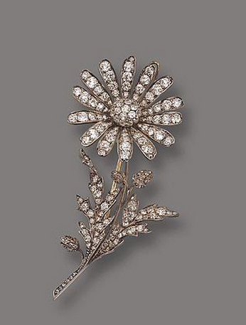 Diamond Flower Brooch. Rene Lalique (1860 -1945). Circa 1890. Gold, diamonds. This piece is typical of the older, Victorian school of jewelry design - lots of jewels in a stylized frame. The Art Nouveau school of thought was to break away from the restrictions imposed on the artist by a reliance on expensive stones, and rather embrace cheaper materials that gave a greater degree of freedom for creative design. It's ironic that now that Lalique's later pieces, while being made from cheaper materials, are worth considerably more than his earlier, jewel-bedecked work.
