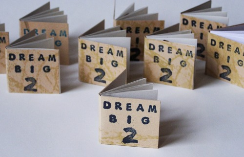 "hyperallergic:  ""Dream Big 2"" by Rejin Leys (2013) This is a 1 inch book that is available in @ArtBoxNY, my vending machine that lives at the Queens Museum. ""Dream Big 2"" is an unlimited edition relief printed accordion book, and is part of a project that reflects my interest in tchalas, books that give lottery numbers for images you might see in your dreams."