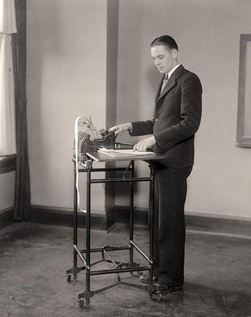 Man using adding machine at Strayer's Business College