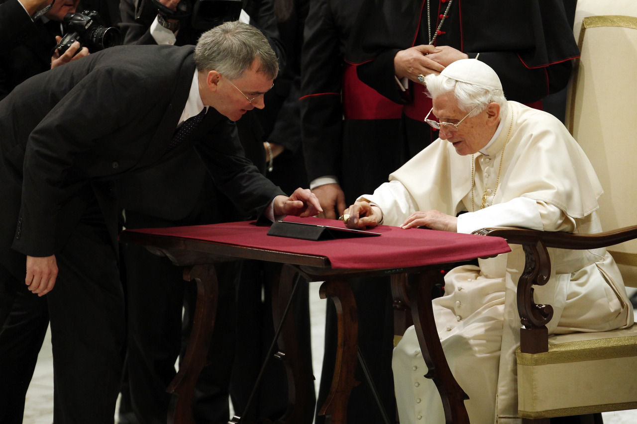 "After weeks of anticipation bordering on media frenzy, Pope Benedict solemnly put his finger to a computer tablet device on Wednesday and tried to send his first tweet - but something went wrong. Images on Vatican television appeared to show the first try didn't work. The pope, who still writes his speeches by hand, seems to have pressed too hard and the tweet was not sent right away. So, he needed a little help from his friends. Archbishop Claudio Maria Celli of the Vatican's communications department showed the pontiff how to do it, but the pope hesitated. Celli touched the screen lightly himself and off went the papal tweet. ""Dear friends, I am pleased to get in touch with you through Twitter. Thank you for your generous response. I bless all of you from my heart,"" he said in his introduction to the brave new world of Twitter. READ ON: Pope needs help sending out blessing in first tweet"
