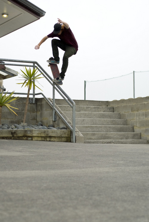 My olds Fs Nosegrind photo down Hockey Rail.