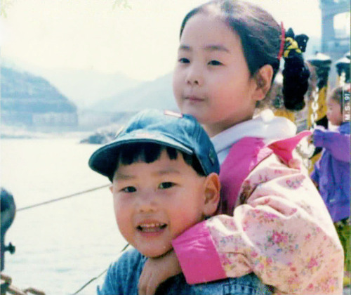 kyuhyun's childhood photo with ahra (1000x769px)without mamma mia's logo / edited by blueprincez