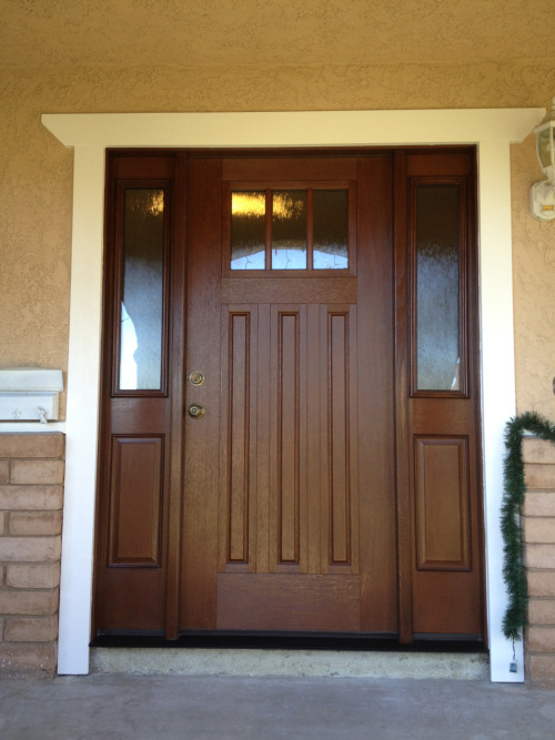 If you need a front door like these folks did, just give us a call! Custom Therma-Tru fiberglass entry door with sidelights.