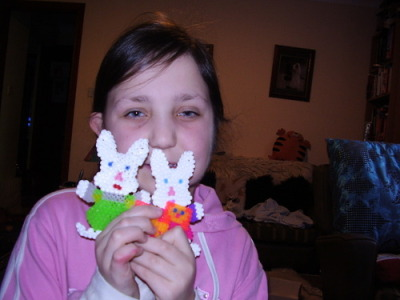 I love doing hama beads, this is me with 3 hama beads I have done.