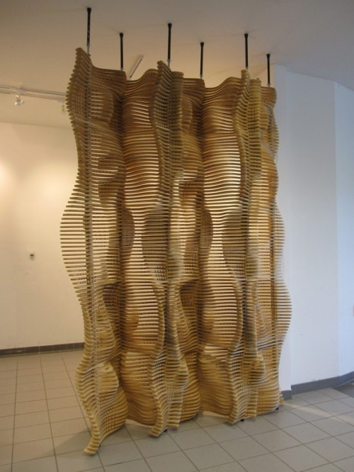 ZERO/FOLD SCREEN Although digital fabrication has allowed architects and designers to explore more complex geometries, one of the byproducts has been a lack of attention to material waste. Often digitally fabricated projects are generated from a top-down logic with the parameters of typical material sheet sizes being subordinated to the end of the design process. This project attempts to reverse that logic by starting from the basic material dimensions and then generating a series of components that will minimize material waste during CNC cutting while still producing an undulating, light-filtering screen in the gallery. Via MATSYSTEM