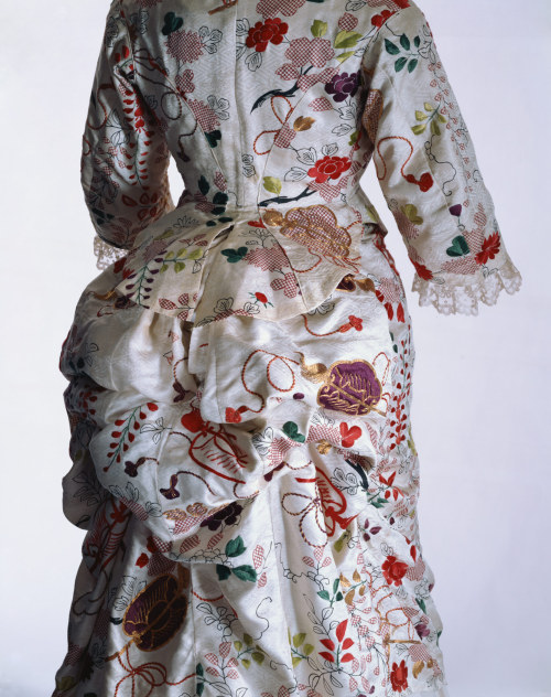 fashionsfromhistory:  Dress 1870s  This dress was remade from a Japanese kimono in London. Some traces of the original kimono seams remain in the textile. The underskirt is missing, but it is thought that an underskirt made of a different fabric was combined with this garment. There are some other indications of missing original ornaments. In the late 19th century kimonos and textiles from Japan captured of the interest of many people in Western countries. Women in America and Europe made dresses from Japanese kimono fabrics and sometimes unstitched kimonos to make new dresses. They also wore kimonos as indoor wear. They especially favored kimonos for women in the highly ranked warrior families at the end of the Edo Period, like the source material for this dress.  KCI