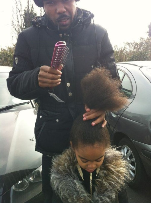leighving:  This picture of my friend brushing his daughter's hair made me melt. Love it!!