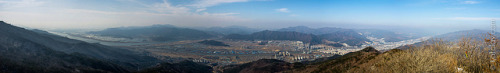 Yangsan Panorama on Flickr.Via Flickr: I was hiking a couple of weeks ago near Geumjeongsan in Busan. While out I snapped this panorama of Yangsan. The mountains are a central part of the Korean landscape. Cities are built around the mountains, wherever you are you can always find a mountain to climb. The resolution of this panorama is 48 megapixels when stitched together in photoshop. It looks great large, but unfortunately you can't get all the details on screen.