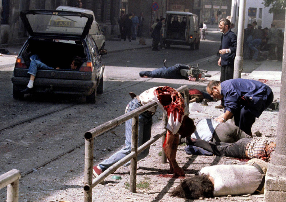 simply-war:  Dead and wounded people lie scattered outside Sarajevo's indoor market after a mortar shell exploded outside the entrance to the building, on August 28, 1995. An artillery shell killed at least 32 and wounded more than 40 others. (Reuters/Peter Andrews)