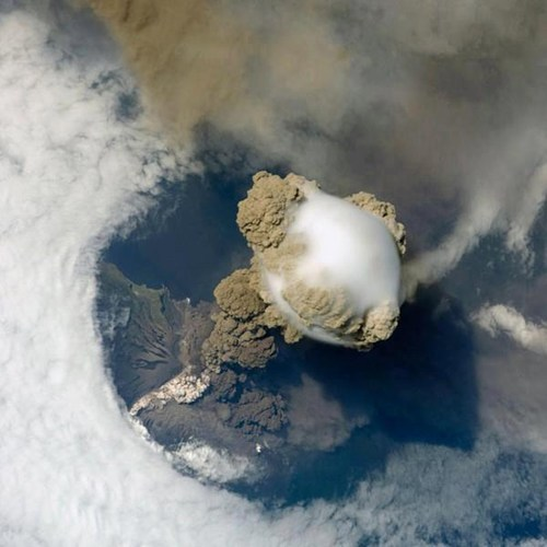 thedailywhat:  A New Perspective of the Day: This is What a Volcanic Eruption Looks Like from Space  Here's a striking view of Sarychev Volcano in Kuril Islands of Japan going through its early stage of eruption, taken from the orbit of the International Space Station in June 2009. For more info on this picture, head over to NASA's Earth Observatory!