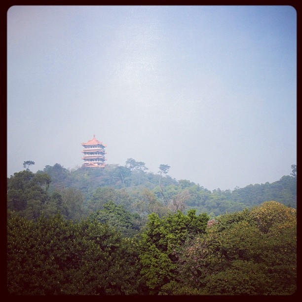 Chinese shrine on top of mountain. #china #shrine #mountain #forest #trees #bluesky #tower #prayers #god #lord (at Guangzhou)