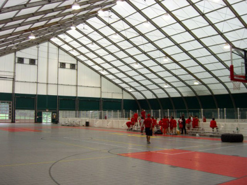 A tension fabric structure used for a multi-purpose sports facility. Affordable, dynamic and relocatable.