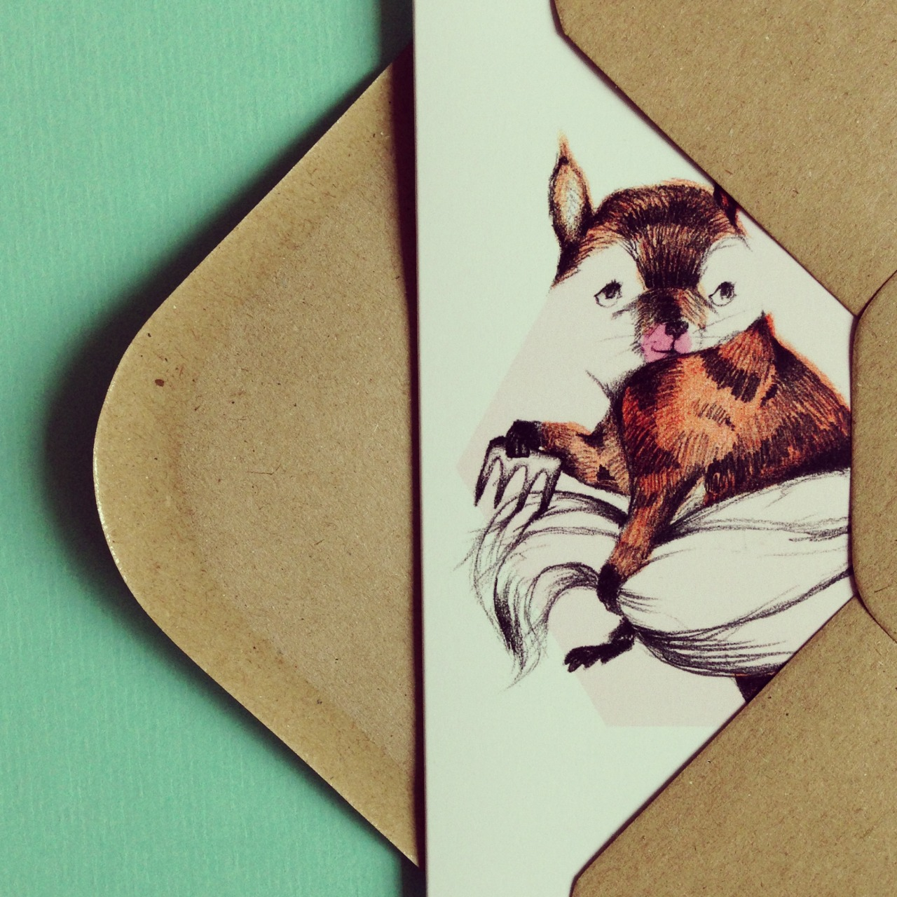 The shy squirrel card. https://www.etsy.com/listing/124774162/shy-squirrel-pencil-illustration
