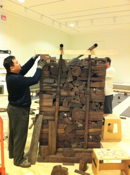 Ai Weiwei's studio assistants assembling Kippe (2006) at the IMA.