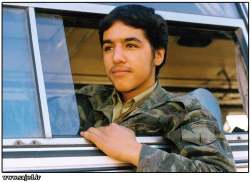 A Young Iranian soldier looks outside from the window of a bus in Tehran as he waits to be sent to the fronts of Iran-Iraq War (Circa 1980's)
