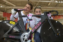 Miriam Welte and Kristina Vogel kissing their FES track bike  after winning the gold medal at the track world championships 2013.Congratulations!