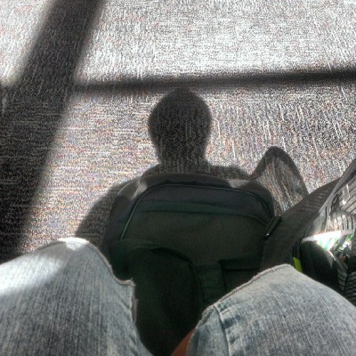 My shadow as I await to board this plane. #Cannes2013