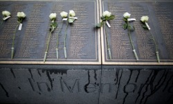 Roses lie on the names of the 1503 people who died as a result of the sinking of the RMS Titanic, following a Titanic Memorial Service at Belfast Titanic Memorial Garden, City Hall, Belfast, Northern Ireland. Relatives of those who died on the ship laid wreaths at the memorial garden to mark the 101st Anniversary of the sinking. Photograph: Peter Morrison/AP