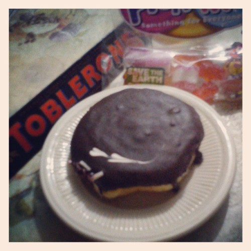 Breakfast… Healthy? Not!!! Sweet tooth! #chocolate #tobleron #dark #donut #coffeefilled #darkchocoaltecoated #gummybears #candy