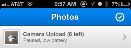 Dropbox - iOS app automatically pauses Camera Upload when the battery is running low.
