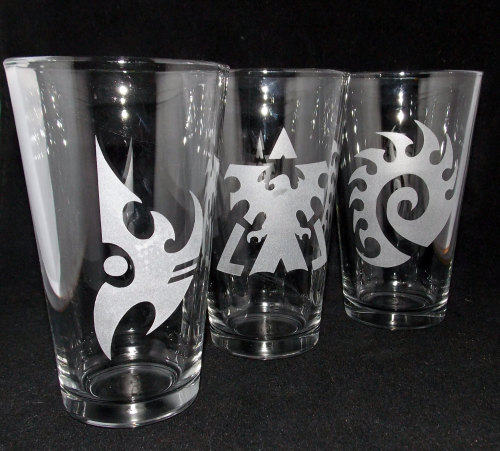 StarCraft Pint Glass Setby CyberGlassware - $30 Fill your glass and toast to you a battle won! Artist CyberGlassware has etched the logos of each race on these pint glasses. The set is perfect for a night of Barcraft or a house divided.