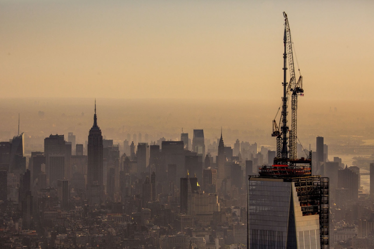 insiderimages:  The final piece of the spire at One World Trade Center is lifted into place in New York, May 10, 2013. The tower now rises to a symbolic 1776 feet, making it the tallest building in the western hemisphere. INSIDER IMAGES/Gary He (UNITED STATES) To license these images and more, click here.  I <3 NY