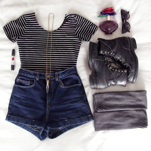 Outfit of the Day American Apparel: crop top, high-waisted shorts, knit thigh-high socks. Vintage: combat books, cat-eye glasses, pendant necklace. MAC: Ruby Woo lipstick. Marc Jacobs: Lola perfume.