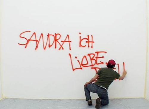 Berlin says (2009) by Nasan Tur Hundreds of graffiti sentences collected from the facades of Berlin walls, sprayed onto one wall over and over again.