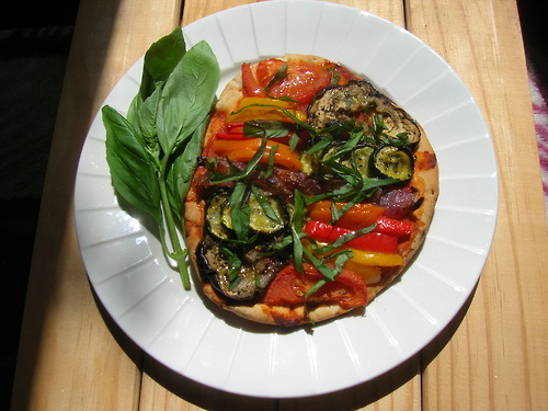 Ratatouille Pizza - roasted eggplant, zucchini, bell peppers, red onion, garlic, tomatoes, thyme and basil on a thick pita bread crust