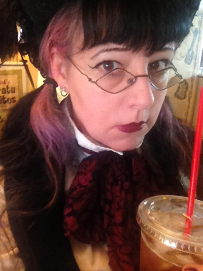 Goth at the Office: still feeling kind of blarg-ish, but content development waits for no one. The bare minimum of makeup, a top hat, and iced coffee.