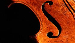F-Hole - Macro Mondays: Music [Explored] on Flickr.My grandfather gave me this old violin over fifty years ago when I was in my young teens. He'd had it for many years before he bestowed it upon me. The story goes that he brought it from Norway when he immigrated to America in 1905, but I can't verify that. I wish I knew more about it. I do remember him playing schottisches and polkas on it; us kids would dance around and laugh a lot when he got going! He preferred his full-sized violin. This is a 3/4 size violin. I believe that it's well over 100 years old. It was very well used when I got it and has been through a lot. We'd play with it when we were kids, not realizing how much I'd treasure it today. Created using 16 frames and focus stacking.