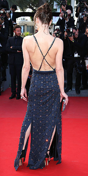 Better From The Back? Milla Jovovich The supermodel veers dangerously close to a wardrobe malfunction in this Prada gown consisting of a black silk top and navy skirt with gemstone detailing.