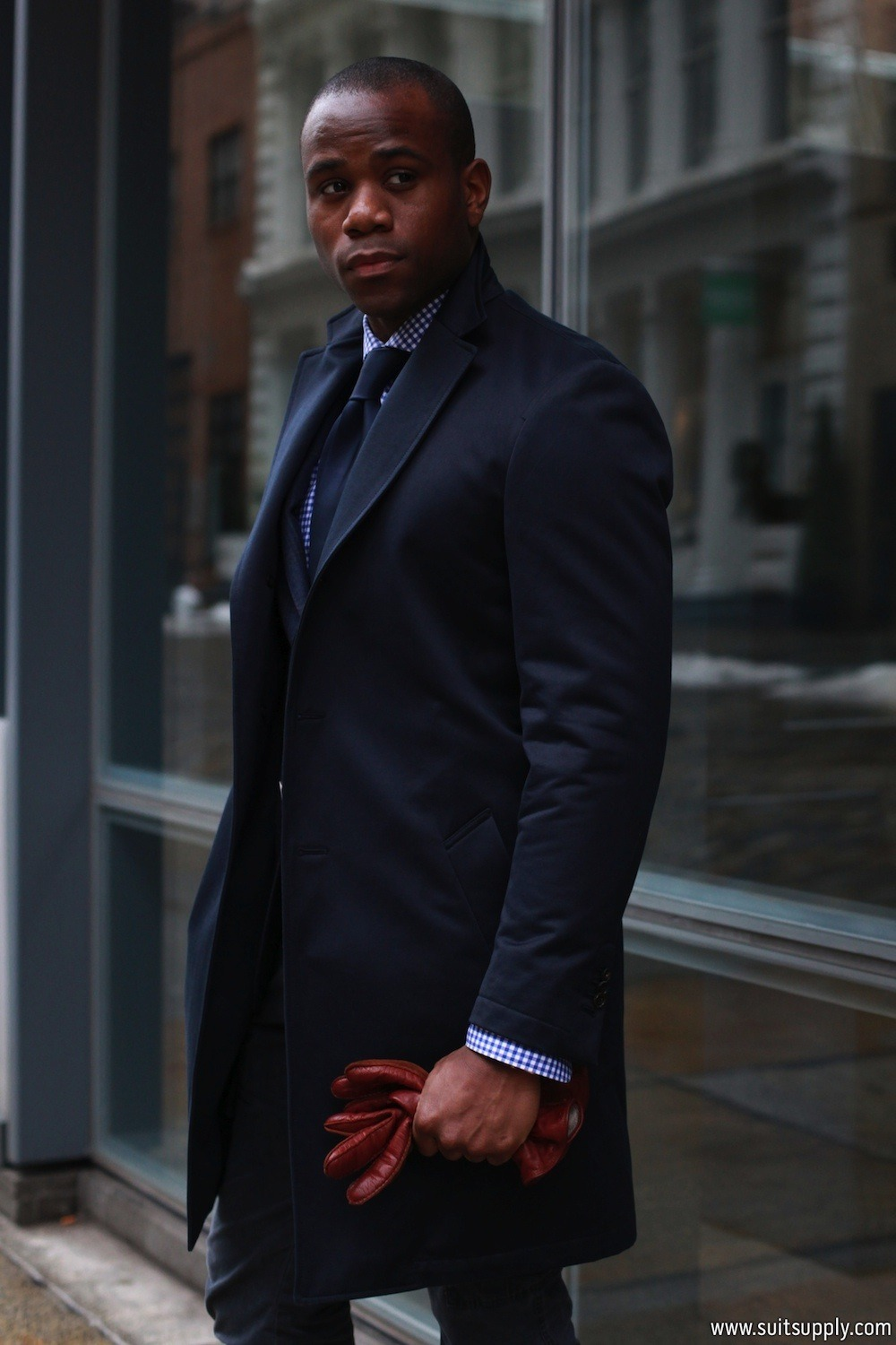 menofhabit:  suitsupply:  Rain Check Jumping from one meeting to the next without a proper raincoat can be tough on your tailored clothing when the weather isn't on your side. It's for those days that we designed this slim cotton jacket that you can easily throw on over your suit when you're running out the door.  Martel.