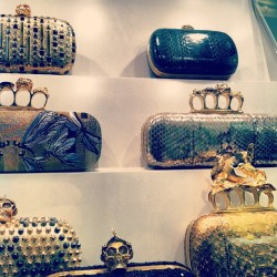 Quirky, creepy, skull endorsed solid clutch purses by Alexander McQueen #mcqueen #fashion #style #accessory #quirky #skull #metal #studs #bling #gold #black #silver #newyork #nyc #shopping #bag #clutch #purse (at Alexander McQueen)