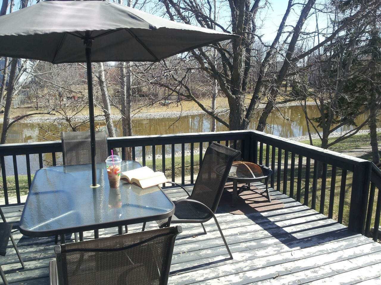 The deck is ready for summer!  In a few weeks we'll have the green shade from nearby trees and we can start having bonfires. Today, however, will involve some much needed suntanning, a delicious Slurpee and Sherlock Holmes!