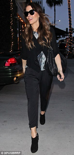 SPOTLIGHT.  Kate Beckinsale in Beverly Hills wearing our Vapor Jacket, Hol 12 Pheasant Print Top and Pre-Spring 12 Solar Drape pant.
