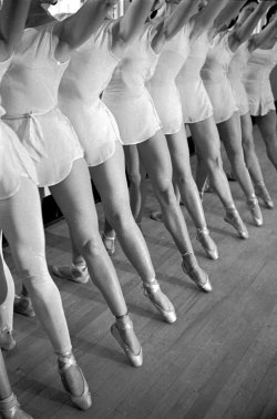 "life:  Caption from LIFE. ""One third of a ballet dancer's time is spent in idle waiting around, two thirds in violent motion. Here a group point their toes, stretch their leg muscles, develop supreme suppleness."" See more photos here. (Alfred Eisenstaedt—Time & Life Pictures/Getty Images)"