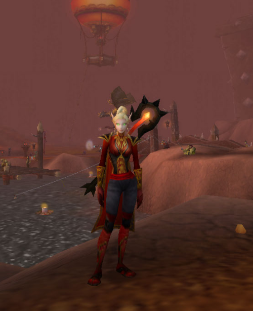cakefortwo:  New transmog for my warlock! We ran Black Morass about 12 times to get that damn staff… but it's totally worth it. <3 Red Workman's Shirt Cindercloth Vest Apothecary's Waistband Fire Striders Bloodfire Greatstaff Archmage Mantle ?? (pants) I don't remember what the pants were, but if anybody is absolutely dying to know (or happens to know off-hand? they have red on the bottom and end just below the knee…) then leave me a note and i'll go look <3
