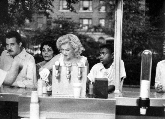 theniftyfifties:  Marilyn Monroe in New York City, June 1957. Photo by Sam Shaw.
