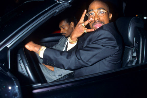 "24ktphoto:  beenkillingshit:  jonathonyork:  Kevin MazurSnoop Dogg and Tupac Shakur leaving the 23rd Annual American Music Awards, 1996  snoop lookin hella emotional  lol ""An emotional Snoop."""